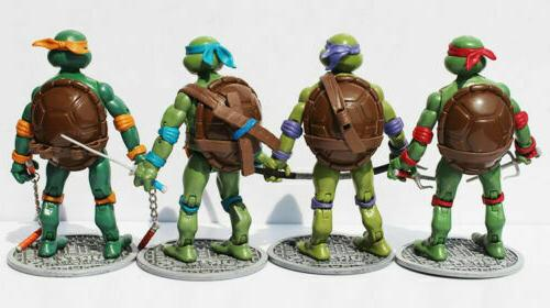 4 Pcs Teenage Mutant Ninja Turtles w/Base Donnie Leo Ralph
