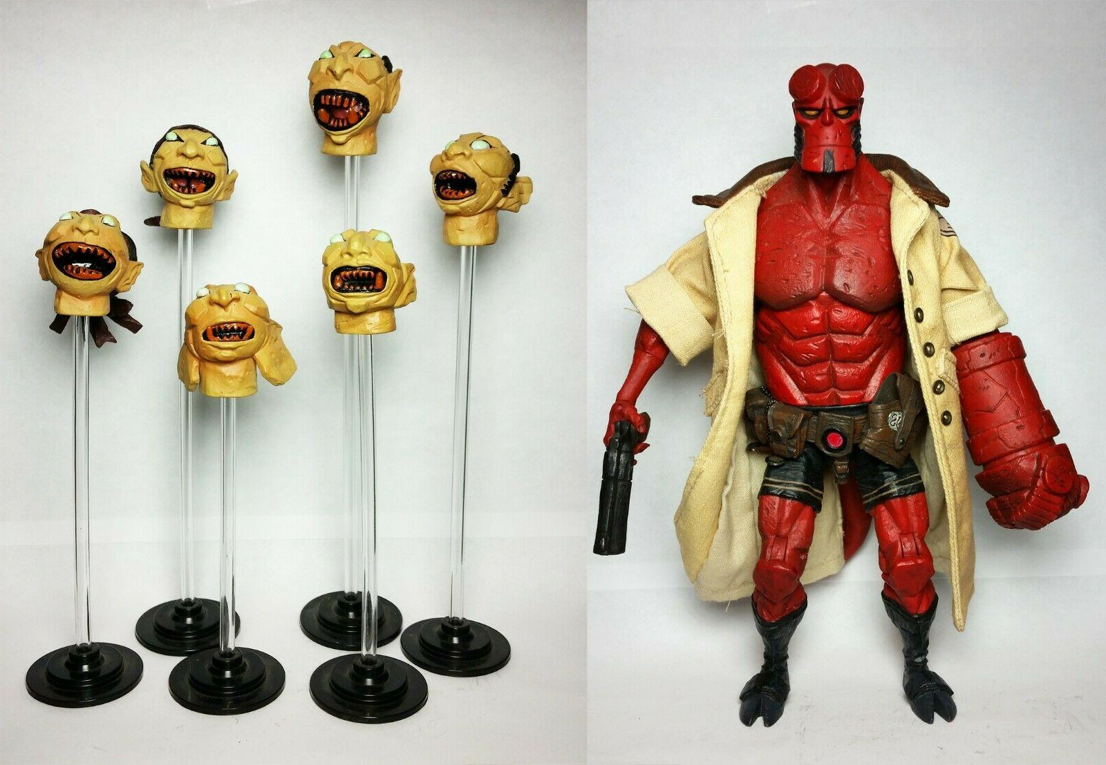 comic hellboy with floating heads action figure